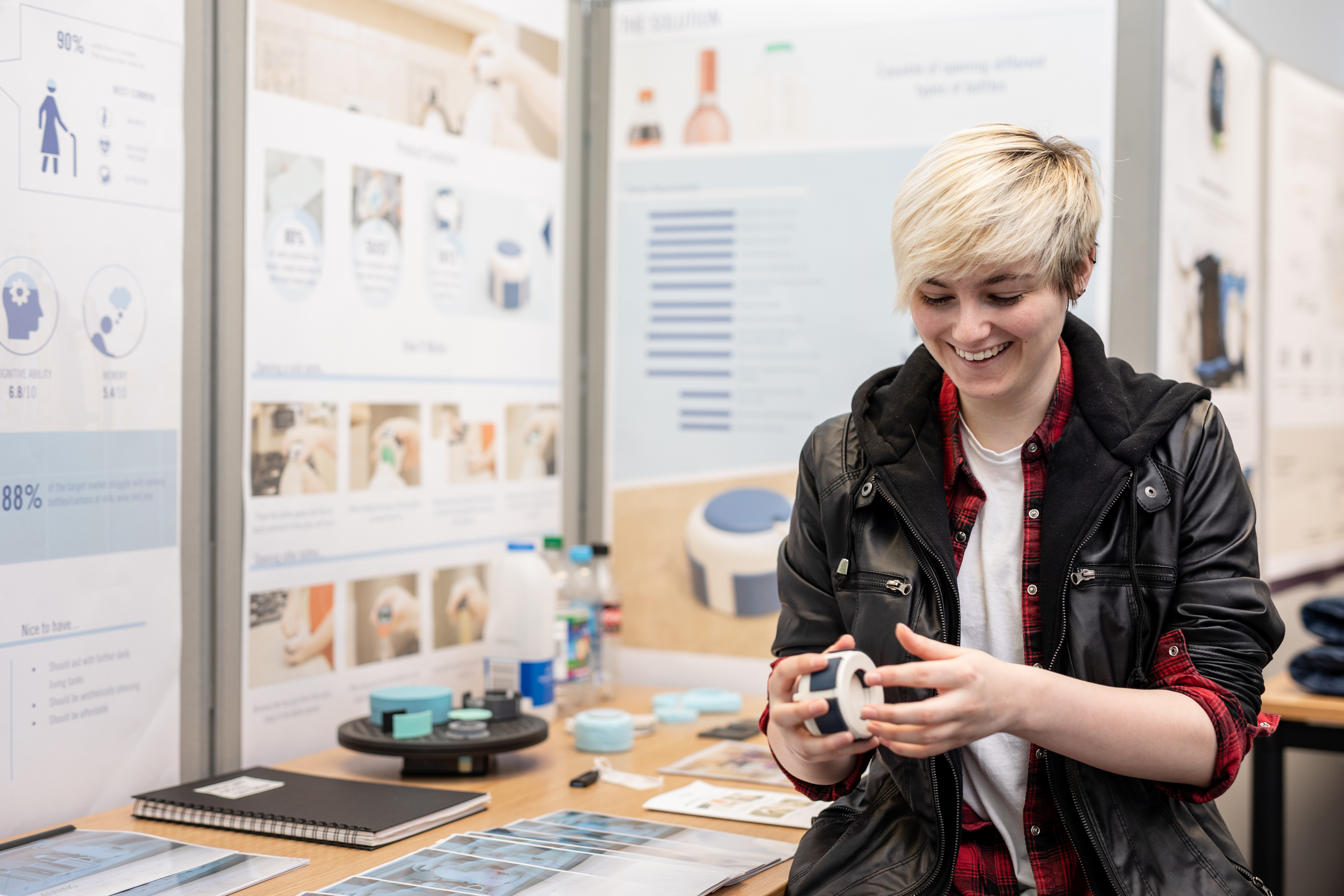 Product design student at the product design showcase with her project
