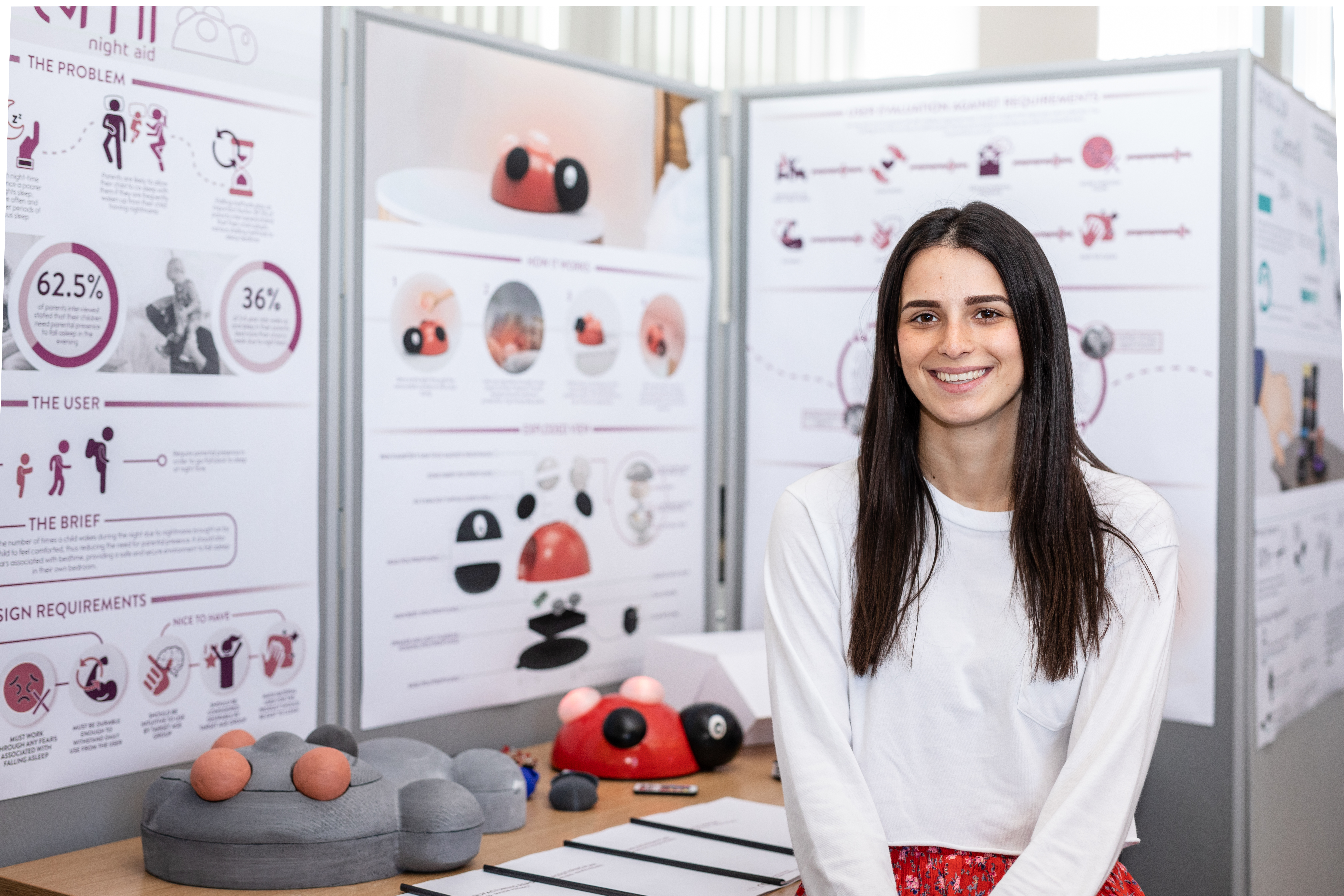 Female product design student with project at showcase