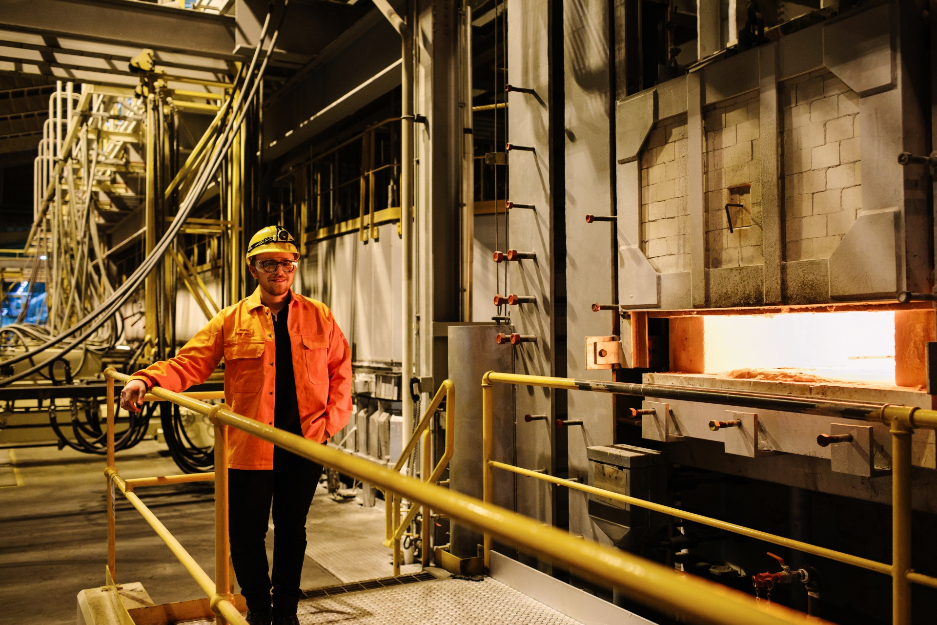 Alex Starling wears protective clothing in a factory