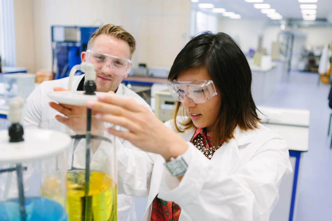 Melissa Huang working with test tubes in a laboratory