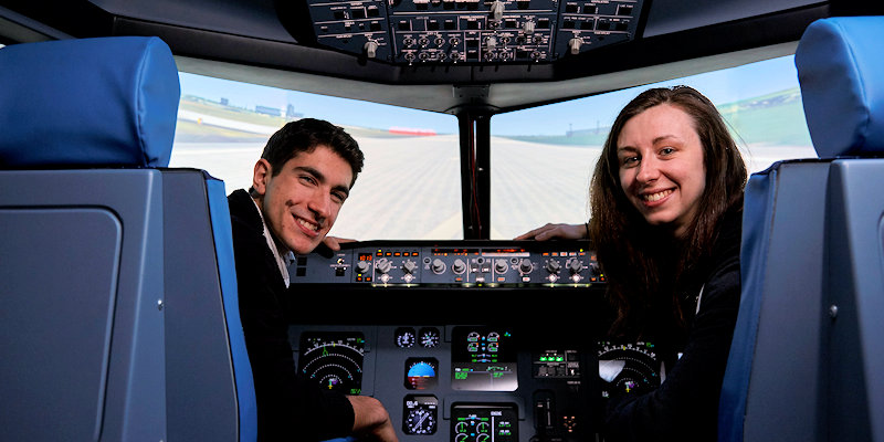 Ioannis and female student in flight simulator