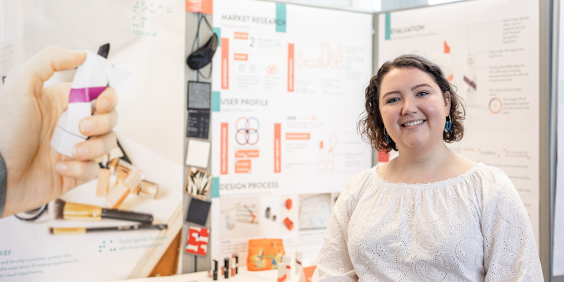 Female product design student with project at product design showcase