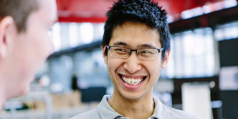 Male student smiling in thermofluids mezzanine