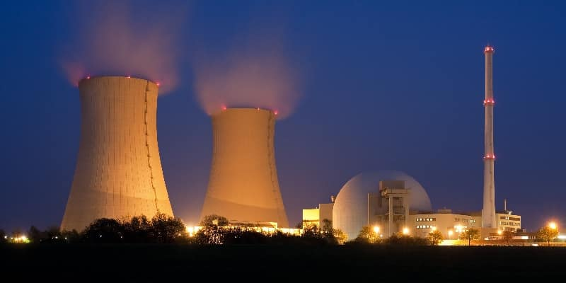 nuclear power station floodlit at night