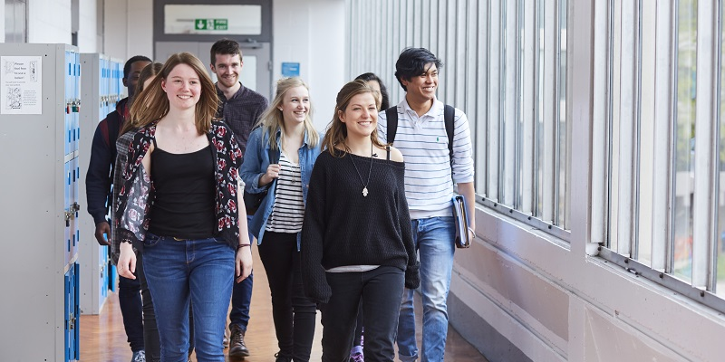 Students walking through the School of Physics and Astronomy at the University of Leeds