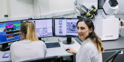 Students using electron microscopes in chemical engineering