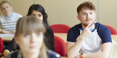 Prospective maths students listen intently during a mathematics application visit day