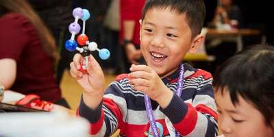 Kid holding a molecule model