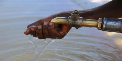 Image of handwashing from outside tap