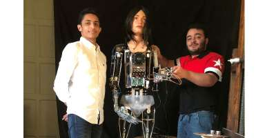 students Salah Al Abd and ziad Abass with Ai-Da