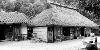Black and white picture of an old house as part of an ecomuseum