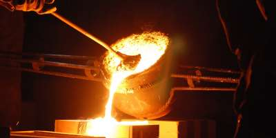 Pouring hot molten metal