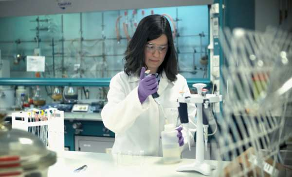 Female postgraduate researcher working in the lab